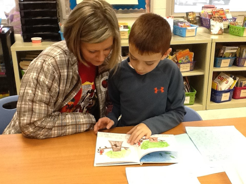 Parents read with the child during a Title I read in a day