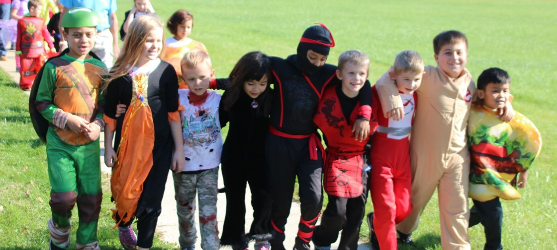 John Clem students walk in the school's annual costume parade