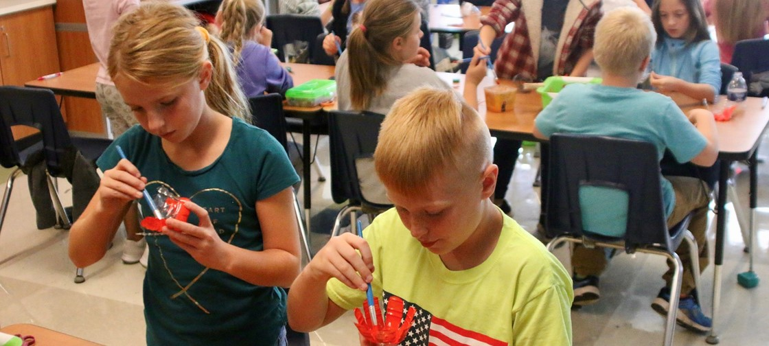 Legend students create poppies out of water bottles for Veterans Day