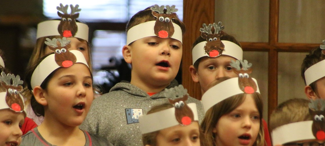 Legend 2nd grade students sing at Sharonbrooke Senior Living
