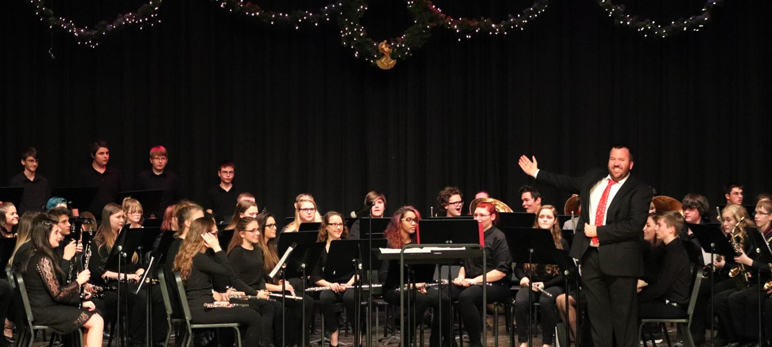 Mr. Auer presents the band at the Winterfest concert