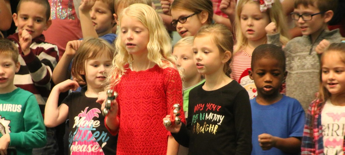 Carson Elementary 1st grade students sing during their holiday concert