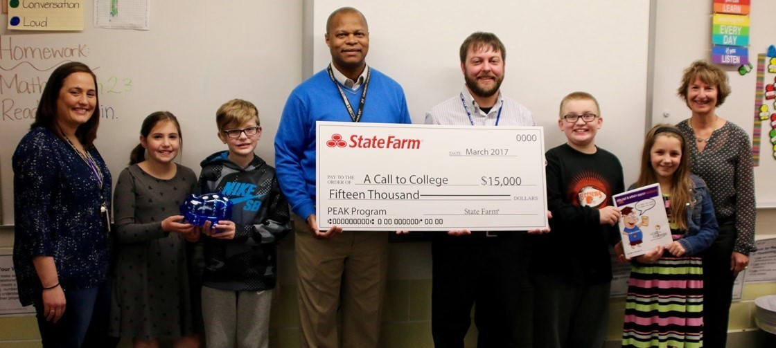 Tom Ash, Center Left, and Jeff Gillham, Center Right, of State Farm present a $15,000 check to A Call to College's PEAK Program
