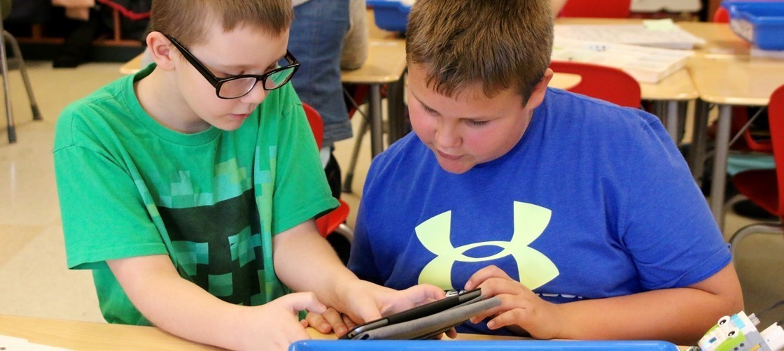 Students work together to program a Lego robot at Cherry Valley