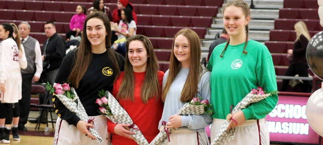 NHS Senior Girls Basketball players, who led the team to an undefeated regular season record at 22-0