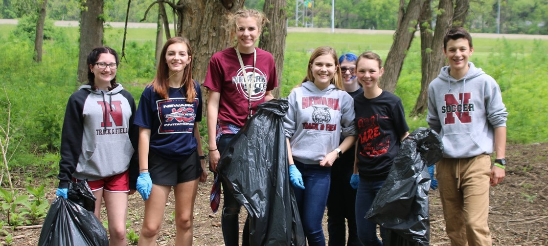 NHS Students help clean up near the bike path for the annual Community Clean Up Day