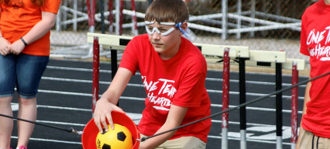 Middle school engineering students competed in a slingshot competition, trying to hit targets with their shots