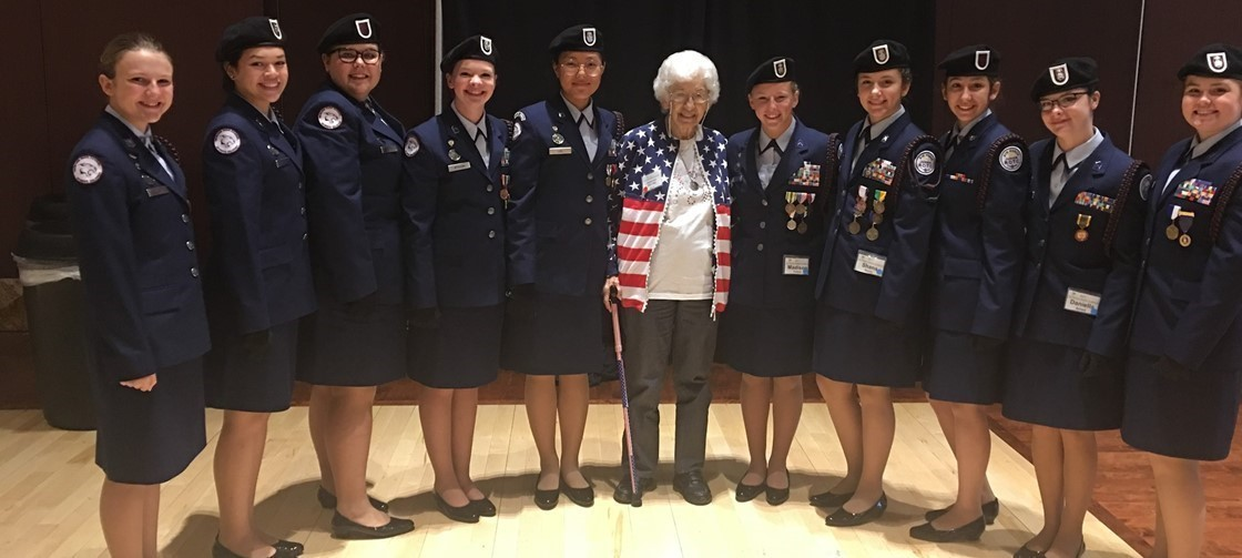 Newark HS Jr. ROTC stands with an NHS alum and World War II Veteran during the annual Ohio Women Veterans Conference