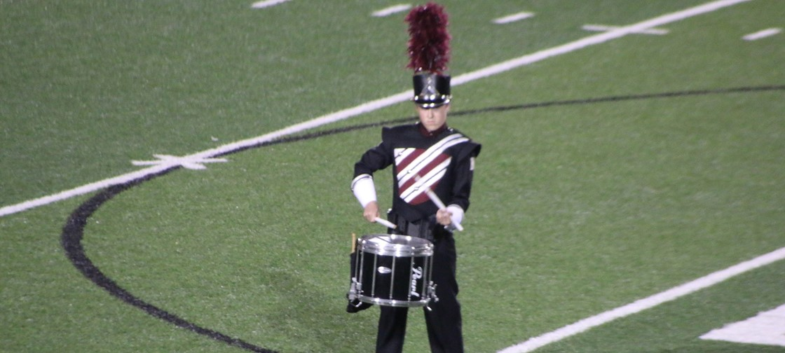 Pride of Newark Marching Band performs during halftime, wearing their new uniforms