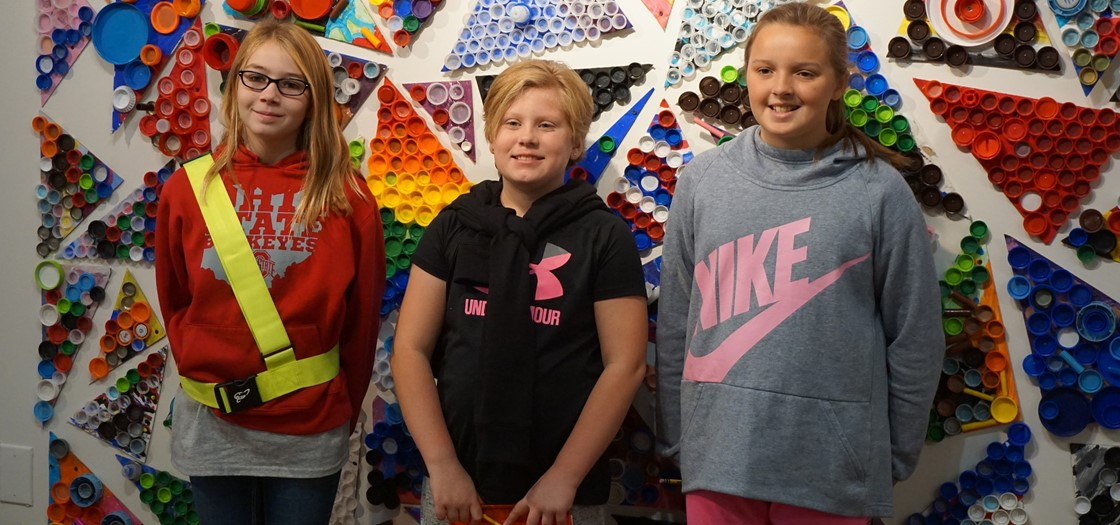 McGuffey 5th graders visit Denison Art Space, where a Bottle Cap Mural they made is on display