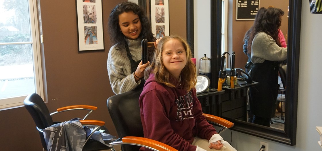 A Newark High School student gets her hair styled during a trip to LifeTown Ohio, a realistic indoor village designed for students to practice important life skills through roleplay