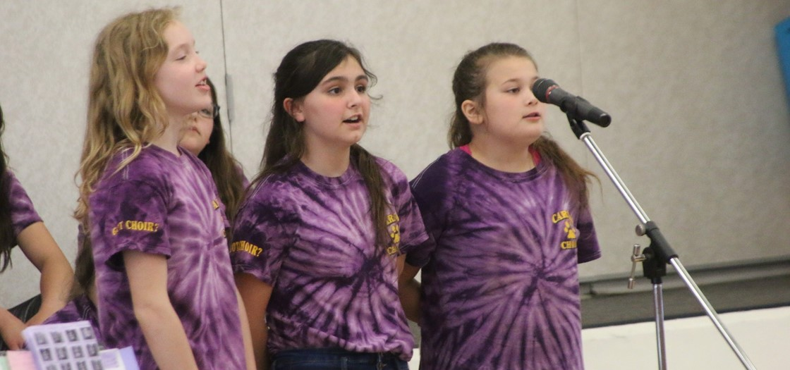 "A trio sings ""Riptide"" during Carson Elementary's spring Choir Concert"