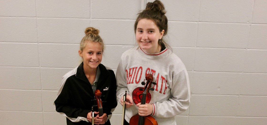 Sophomore Noel Zarnosky, left, and senior Taylor Jacobs qualified for the East Central Region Orchestra this November in Ashland.