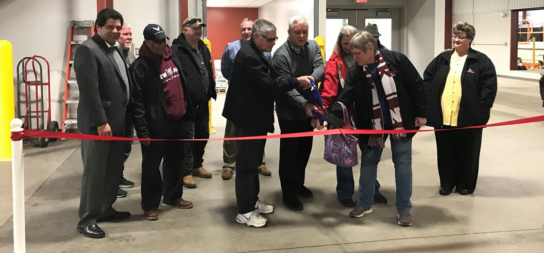 Board members, administrators and bus drivers cut the ribbon on the renovated bus garage