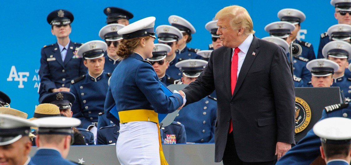 NHS alumna Meghan Roche, left, was commissioned a 2nd Lieutenant after graduating from the United States Air Force Academy. She was congratulated by the President of the United States.