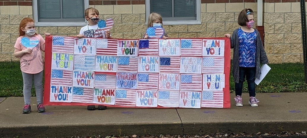 Carson Elementary students thank Veterans during a Veterans Day drive-through celebration