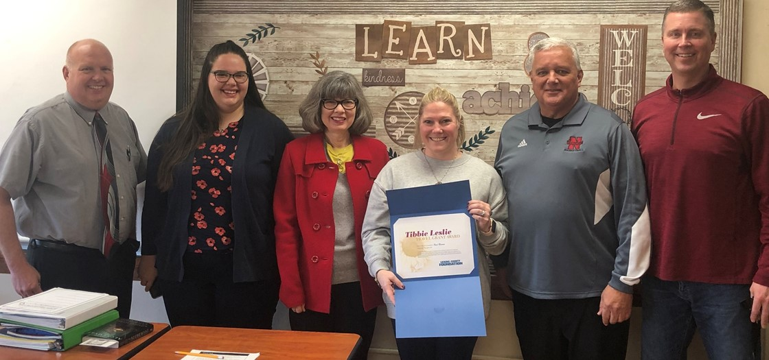 Noel Blevins, center, received a Tibbie Leslie Travel Grant from the Licking County Foundation. Blevins, an intervention specialist at Wilson Middle School, will travel to England.