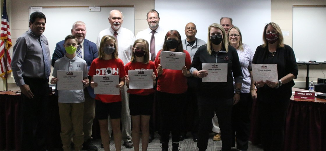 Wildcat Spotlight award winners from Heritage Middle School at the October 2021 board meeting