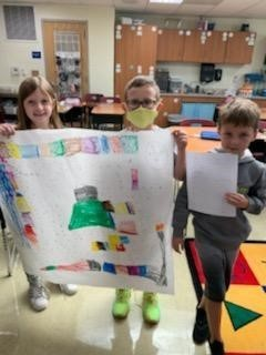 2nd graders working on creating their own maps!
