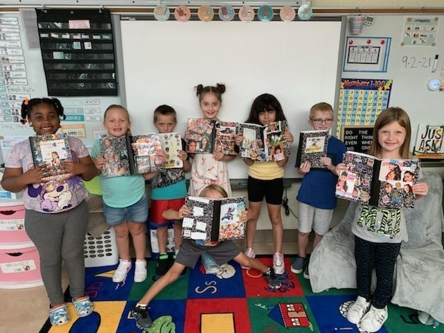 2nd graders decorating their writer's notebooks for the school year