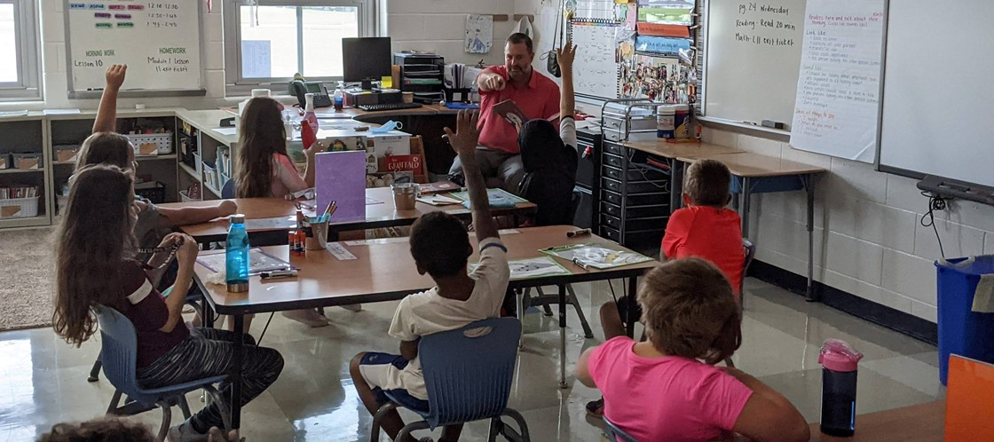 Superintendent David Lewis reading to a 3rd grade class at Legend Elementary