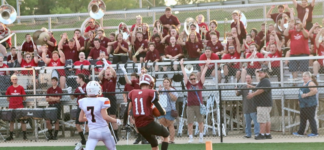 The Wildcats score a touchdown as the band cheers them on